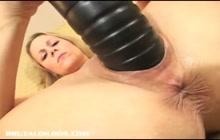 Busty MILF toying her gaping pussy